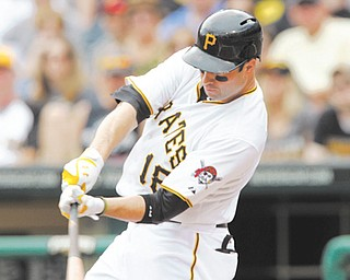 Pittsburgh Pirates' Neil Walker hits a single in the first inning of a game against the San Diego Padres on Sunday in Pittsburgh. Walker went 5-for-5, driving in two runs and scoring two runs as the Pirates won 11-5.