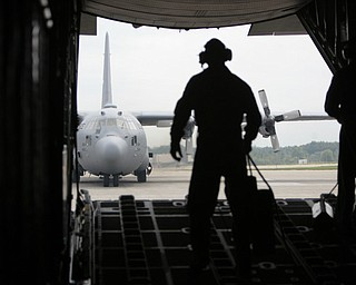 ROBERT K. YOSAY  | THE VINDICATOR..Back on the ground SRA Marcus Watson  opens the rear hatch  as a C130 H follows in formation -  -30-