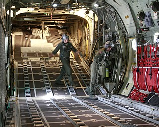 ROBERT K. YOSAY  | THE VINDICATOR.. cleaning up straps in the back of the C-130 after it dropped a 3000 lb payload is  SraMarcus Watson and Sgt James Hudson -30-