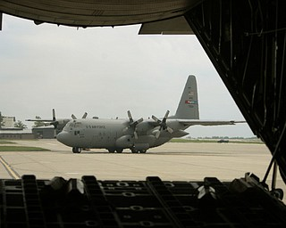 ROBERT K. YOSAY  | THE VINDICATOR.. a C130 H follows in formation  is framed by the back of another palne -  -30-