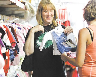 (L-R) Christine Jugenheimer and Heather Jugenheimer of Salem, Ohio shop at Kidzone, also in Salem, Ohio, for newborn dresses on August 14, 2012.