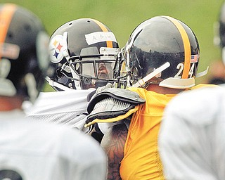 Pittsburgh Steelers wide receiver Antonio Brown, left, and defensive back Ike Taylor (24) grab each other during a confrontation after a play during training camp in Latrobe, Pa. Brown and Taylor have gotten into two scuffles during recent practices.