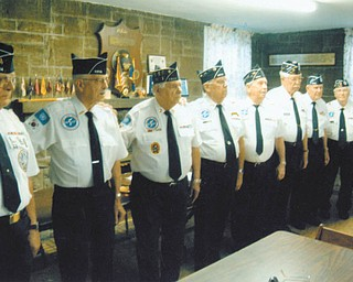 The Korean War Veterans Association Mahoning Valley Chapter 137 installed officers recently. From left to right are Commander Paul Lawson; First Vice Commander Lloyd Edwards; Second Vice Commander Bob Vitullo; Secretary Frank Sloth; Treasurer Harold Baringer; three-year trustees Bob Bakalik and Wickham Flower; and Chaplain (retired) Richard Koker.