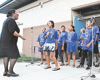 The Williamson Elementary School Voices of Hope Choir sings a song about hope Sunday during the Williamson Back To School Rally and Block Party. About 300 people attended the event at the school.