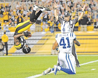 Steelers wide receiver Antonio Brown flips into the end zone over Indianapolis Colts defensive back Antoine Bethea for a touchdown in the first quarter of their preseason game Sunday night in Pittsburgh.