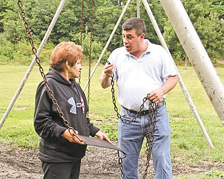 Roz Gadd, left, and Mike Costarella talk about a broken swing, which is one of many repairs needed at Liberty Memorial Park in Girard.