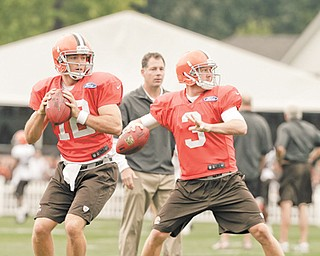 Cleveland Browns quarterbacks Colt McCoy, left, and Brandon Weeden (3) practice Tuesday in Berea. Despite being delegated to the backup role, McCoy says he is happy in Cleveland.