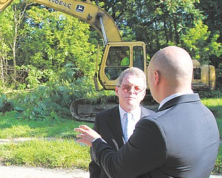 The house at 1018 High St. in Youngstown was torn down Wednesday during a news conference with city and Mahoning County officials and Ohio Attorney General Mike DeWine, facing front. Mahoning County received $1.5 million through the AG's Moving Ohio Forward Grant Program. Of that, $1 million is going to the city.