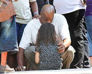 Mourners console each other after the funeral of Bryce Linebaugh, 8, Friday, Aug. 24, 2012.