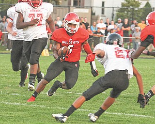 Tommy Kimbrough (6) of Struthers cuts past Campbell's Corey Hamilton (21) on his way to a touchdown in the second quarter of Thursday's game in Struthers. The Wildcats came out on top of the rivalry with the Red Devils, 26-20.