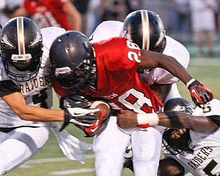 ROBERT  K.  YOSAY  | THE VINDICATOR --..No Where to go as Fitchs #28  Tyreese Anderson  is tackled by three Raiders   #14  Jimmy Rumple - #2  Aaron Quails andd #5  Lyndal Kimble for no gain in the second quarter..Warren Harding @ Austintown Fitch -Fitch Stadium...(AP Photo/The Vindicator, Robert K. Yosay)