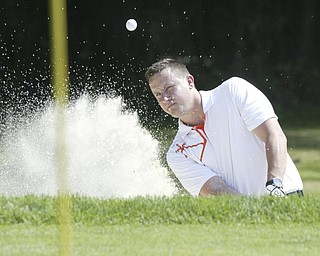 William D Lewis The Vindicator  Steve Davies blasts out of sandtrap Friday at Mill Creek.