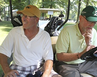 William d Lewis the vindicator Rick Haldi, left, and Paul Leonard check their scores Friday at Mill Creek.