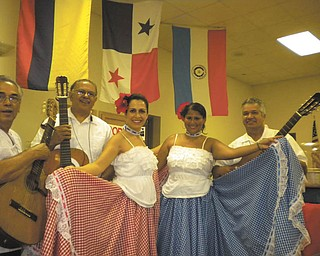 Organizacion Civica y Cultural Hispano Americana celebrated its first International Latino Food Fest Aug. 10 at the OCCHA Hall on Shirley Road. Foods were from Argentina, Chile, Colombia, Cuba, Dominican Republic, Mexico, Peru, Puerto Rico, Spain and Venezuela. The event benefited OCCHA's children's programs. Entertainment was provided by Trio Riqueno of Puerto Rico, Chile Tradicion of Chile and Sabor Latino of Colombia. Some of the entertainers, from left to right, were Manuel Reyes and Felipe Gonzalez of Trio Riqueno, Paulina Montaldo and Claudia Orozco of Sabor Latino and Tomas Molina, also of Trio Riqueno.