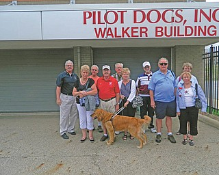 A group of 11 from Austintown, Canfield and the new West Mahoning County Lions clubs visited Pilot Dogs Inc. of Ohio in Columbus recently. The group was met by Executive Director Jay Gray and toured the facility to learn about guide dogs and their role with their visually impaired owners. In front, from left, are Joyce Whited, Randy and Shirley Boyles with Pilot Dog Sam, and Ed and Linda Ellis. In back are Gray, John Facemyer, Jack Kochansky, and Jim and Dee Tripp.