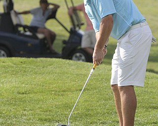 William D. Lewis The Vindicator  Jonah Karzmer putts  at Lake Club Sunday.