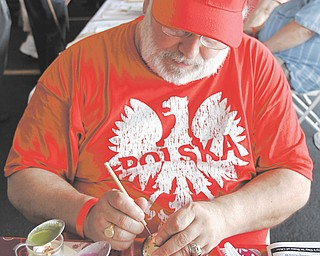 Larry Kozlowski of Pittsburgh decorates eggs with melted wax, a Polish tradition celebrated at Easter, at the fourth annual Polish Day on Sunday in Austintown.