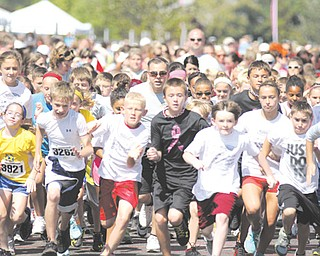 Hundreds of children take off running during the first Kids Run Sunday at the Covelli Centre in Youngstown. The Kids Run was one of three races offered at the third annual Panerathon, which benefits the Joanie Abdu Comprehensive Breast Care Center at St. Elizabeth Health Center.
