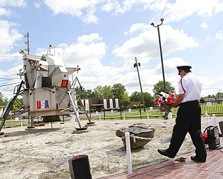 Cortland resident Garey Watson of the Trumbull County Honor Guard places a wreath at the Apollo 11 lunar module replica site on Parkman Road Northwest in Warren. The replica was built a decade ago to honor Neil Armstrong, the first man to walk on the moon, who died Saturday at age 82. A memorial for Armstrong was Wednesday at the site.