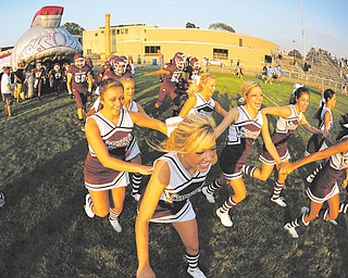 Boardman cheerleaders and players take the field before their game against Cleveland Benedictine
