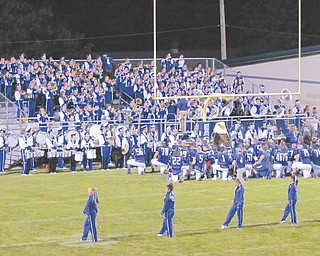 The Hubbard High football team kneels in front of the band as the alma mater is played following the Eagles' 56-0 shutout win over Cleveland Collinwood