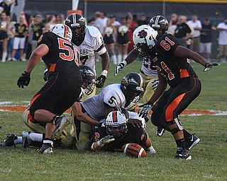 NICK MAYS l THE VINDICATOR.(6) Tyler Drass of Howland fumbles the ball and team mate (61) Jack Finch recovered it during the first quarter in Howland. - harding vs howland at howland  Friday 08312012