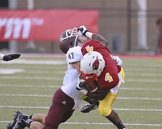 ROBERT K. YOSAY  | THE VINDICATOR..Gaining a tough first down in first quarter action as Mooney (4)  Marcus McWilson puts a stiff arm to  Boardmans  (#47 Brock Hull) .Bdm @ Mooney - Stambaugh Stadium... - -30-..