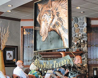 Patrons are greeted by a copper wolf in the dining area of the Blue Wolf Tavern.