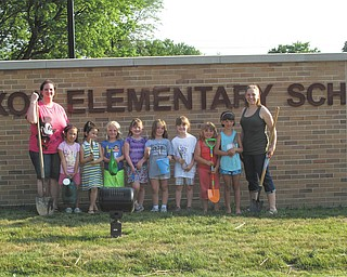 Daisy Girl Scout Troop 80777 of Columbiana, with nine members, planted day lilies at Joshua Dixon Elementary school, where they will be attending classes. The flowers can be seen from the main entrance. From the left are Troop Co-leader Kathy Kaszowski; Girl Scouts Chloe Gill, Mia Surgenivic, Rebekah Clark, Katrina Kaszowski, Elizabeth Siembida, Alaina Johnston, Abbie Passmore and Airianna Scullion; and Troop Leader Crystal Boggs. Absent from the picture is Chloe Loveland. The school principal, Kim Sharshan, donated the flowers for the girls to plant. Girls that are beginning first grade this year can contact Boggs at 330-482-9105 to join Girl Scouting. They will participate in the fall product sales fundraiser and begin selling cookies in December.
