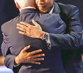 President Barack Obama, right, hugs Former President Bill Clinton after Clinton's nomination speech to the Democratic National Convention in Charlotte, N.C., on Wednesday, Sept. 5, 2012. (AP Photo/Lynne Sladky)