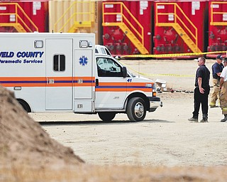 Police and fire offi cials tape off the area after an explosion at an Encana Corp. oil and natural-gas facility near Fort Lupton, Colo. Some offi cials in Colorado would like to keep drilling away from where residents live and work.