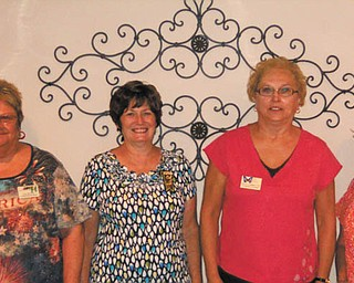 The Tri-Gold Chapter of the American Business Women's Association met recently and installed the executive board for 2012-2013. From left are Kay Myers, secretary; Sharon Pasquale, treasurer; Dolly Sonnenlitter, president; and Elena Nigro, vice president. The chapter meets the second Wednesday of each month and is open to all working or retired women. Call 330-545-5957 for chapter information.