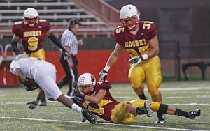 ROBERT  K.  YOSAY  | THE VINDICATOR --..Tripped at the line  svsm  #4 Franshon Bickley is brought down by CM #14 Marcus Penza as Cm #35  Anthon Dermotaa looks on during first quarter action at  Akron St Vincent St Mary @ Cardinal Mooney  at YSU Stadium..(AP Photo/The Vindicator, Robert K. Yosay)