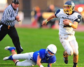 Mcdonald quarterback #2 Christian Rusinowski runs after the missed tackle of defensive back Danny Rosati #5 of Western Reserve on a 4th down an 1. McDonald was successful on the conversion.