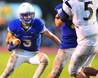 Western Reserve running back #3 Tim Cooper runs the ball down by the goal line during the second quarter.