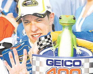Brad Keselowski celebrates in victory lane Sunday after winning the Geico 400 at Chicagoland Speedway in Joilet, Ill.
