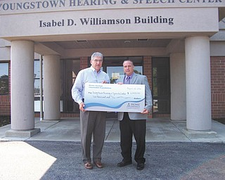 Home Savings Charitable Foundation recently presented Youngstown Hearing & Speech Center, a local nonprofit organization, with a check for $2,000. YHSC Executive Director Alfred Pasini, left, received the check from Frank Constantino of the Home Savings Boardman office. The funds will be used to help people with disabilities or special needs live with dignity and independence. For more information about YHSC and its services, call 330-726-8855 or visit www.yohsc.com.