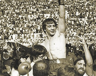 """Mark Kriegel's biography about Ray """"Boom Boom"""" Mancini, shown here celebrating a victory over Ernesto Espana at Warren's Mollenkopf Stadium in 1982, will be released nationwide today."""