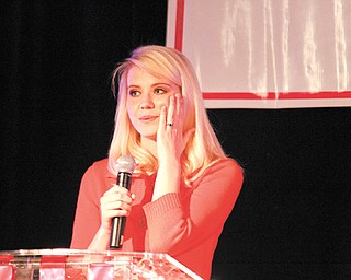 """Elizabeth Smart, ABC news commentator and advocate against child abduction, speaks at the Healthy Woman Expo and Dinner at the Mahoning Country Club in Girard. Smart, who was 14 when she was kidnapped from her Salt Lake City home in 2002 and held for nine months by her kidnappers, spoke of making the decision during her ordeal that she would survive """"no matter what."""" Smart shared her story with 650 women Wednesday night at the expo, which was sponsored by ValleyCare Health Systems of Ohio."""