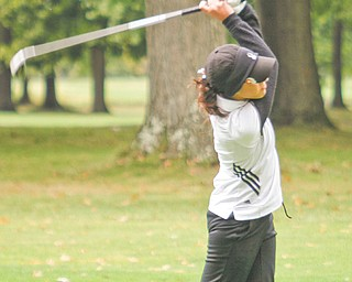 Canfield's Christina Cooper tees off during the girls All-American Conference girls golf championship Wednesday at Tamer Win Golf & Country Club in Bazetta Township. Cooper's round of 85 led the Cardinals to the American Division title and also earned her second place overall.