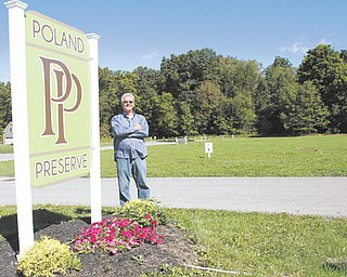 Richard Ohlin of Hubbard-based Quadland Corp. says he's optimistic about the economy as Quadland invests in a development on the former Edgar McCullough farm on North Lima Road, just north of the Five Points intersection in Poland.