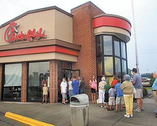 Customers line up outside the Chick-fi l-A Restaurant at New Bern Mall in New Bern, N.C. It is not entirely clear whether Chick-fil-A has definitely ended its financial businsupport for groups that oppose same-sex unions.