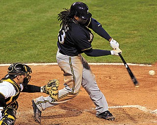 The Brewers' Rickie Weeks hits a triple to left-center off Pirates relief pitcher Chris Resop, driving in two runs, in the eighth inning of Thursday's baseball game in Pittsburgh. Weeks scored the go-ahead run on Aramis Ramirez's single as the Brewers rallied to defeat the Pirates 9-7.