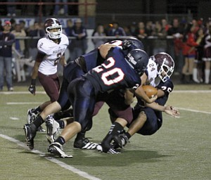 ROBERT  K.  YOSAY  | THE VINDICATOR --..SACK   -  #24 Bdm John Babos.. is  sacked in the second quarter by Ftichs #20  Jared McHenry -  #50  Ryan Sayers and #76  Tony Behanna..Boardman  vs Fitch @ Fitch   ..(AP Photo/The Vindicator, Robert K. Yosay)