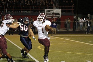 ROBERT  K.  YOSAY  | THE VINDICATOR --..Bdm #1  Takes off for a first down run behing helped by #68  ( not in program and Blocking Fitch's #50  Ryan Sayers - Boardman  vs Fitch @ Fitch   ..(AP Photo/The Vindicator, Robert K. Yosay)