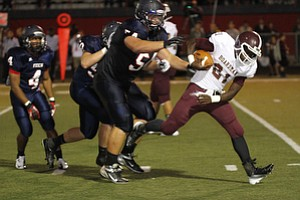 ROBERT  K.  YOSAY  | THE VINDICATOR --..Driven back Boardmans #21  Isiah Lyle is driven back by fitchs #54  Billy Price  and #50   Ryan Sayers  -- -Boardman  vs Fitch @ Fitch   ..(AP Photo/The Vindicator, Robert K. Yosay)