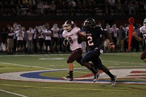 ROBERT  K.  YOSAY  | THE VINDICATOR --..Fitch #2   Kerrell Johnson is off to the races and almost a touchdown in the second quarter as Bdm #8  Ryan Savage gives chase -Boardman  vs Fitch @ Fitch   ..(AP Photo/The Vindicator, Robert K. Yosay)