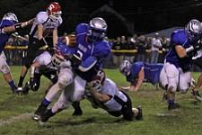 IMG 3544: LJ Scott (3) of Hubbard sheds the tackle of a Struthers defender duringÊFriday nights matchup at Hubbard High School. ÊDustin Livesay Ê| ÊThe Vindicator Ê9/21/12 ÊHubbard, Ohio