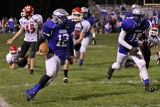 IMG 3565: Hubbard quarterback Brandon Harb (12) looks for an opening while running the ball up the sidelines during the second halfÊof Friday nights matchup against Struthers at Hubbard High School. ÊDustin Livesay Ê| ÊThe Vindicator Ê9/21/12 ÊHubbard, Ohio