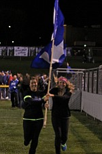 IMG 3619: Hubbard seniors Dana Takash (left) and Megan DeMaiolo (right) run with a flag with a H on it in celebration of a touchdown by the Hubbard High School football team during Friday nights matchup against Struthers mat Hubbard High School. ÊDustin Livesay Ê| ÊThe Vindicator Ê9/21/12 ÊHubbard, Ohio